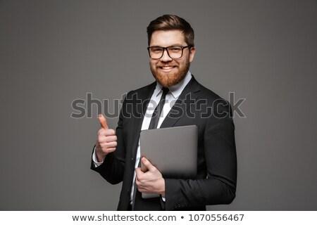 肖像 · 幸せ · 若い男 · ラップトップコンピュータ · 立って - ストックフォト © deandrobot