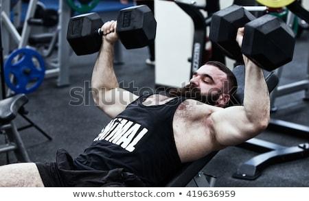 Gömleksiz adam ağır dambıl bank Stok fotoğraf © wavebreak_media