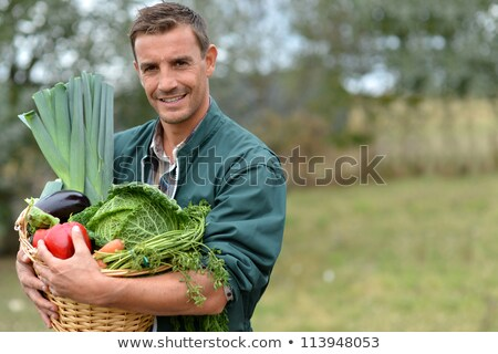 Portrait of  man with vegetable basket Stock photo © IS2