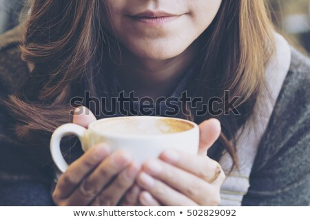 A glum young woman drinking tea in a cafe Stock photo © monkey_business