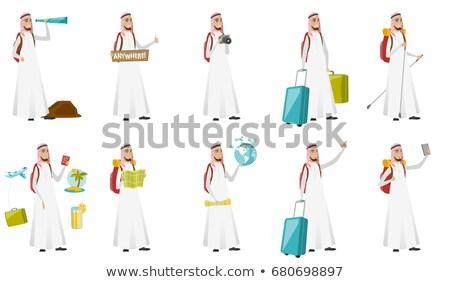 Young muslim traveler hitchhiking. Stock photo © RAStudio