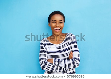 Woman against wall smiling Stock photo © IS2