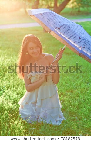 Girl with sun parasol Stock photo © IS2