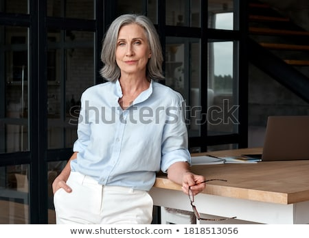 Senior executive standing at table Stock photo © IS2