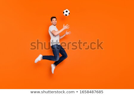 Goalkeeper jumping for the ball. Stock photo © rwgusev