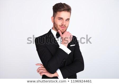 smiling elegant man in tuxedo holding chin is thinking  Stock photo © feedough