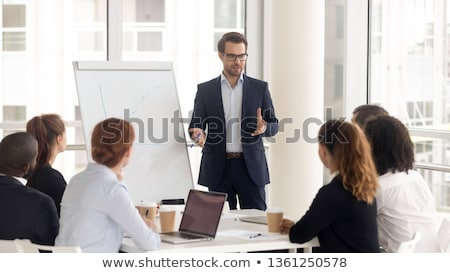 man with flip chart in office meeting stock photo © is2