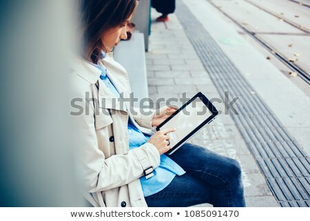 Side view of woman waiting at tram stop Stock photo © IS2