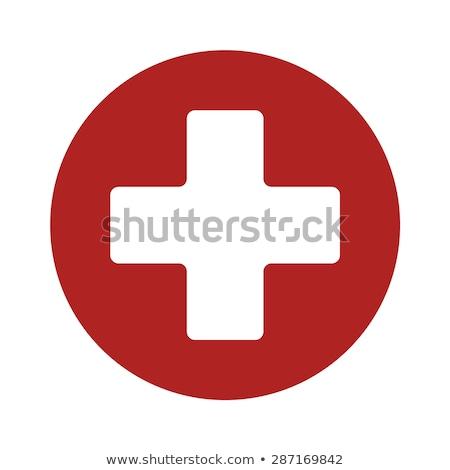 Rojo primeros auxilios signo primer plano médicos blanco Foto stock © AndreyPopov