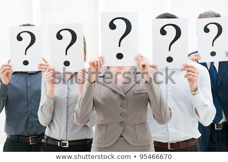 businesspeople hiding their faces behind question mark sign stock photo © andreypopov