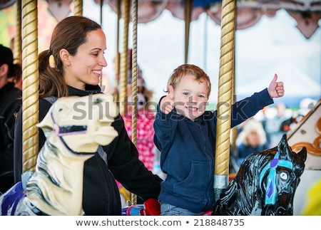 Mom and son having fun at an amusement park Stock photo © galitskaya