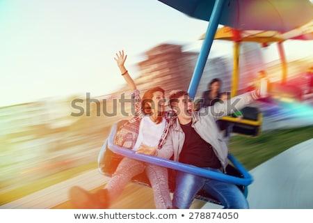 Gyönyörű fiatalember szórakozás vidámpark nő lány Stock fotó © galitskaya