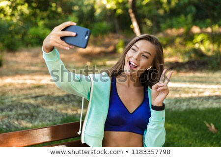 young fit sporty woman and listen to music and taking selfie on stock photo © boggy