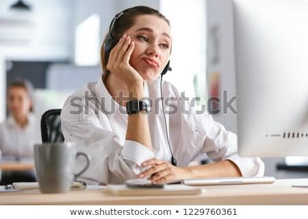 退屈 若い女性 着用 マイク ヘッド シャツ ストックフォト © deandrobot