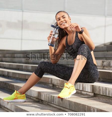 happy woman with fitness tracker on summer beach Stock photo © dolgachov