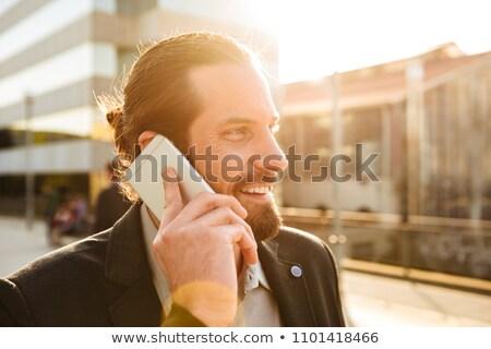 Closeup photo of sunlit businesslike man 30s in formal suit smil Stock photo © deandrobot