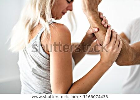 Gwałtowny człowiek kobieta ramię rodziny Zdjęcia stock © Lopolo
