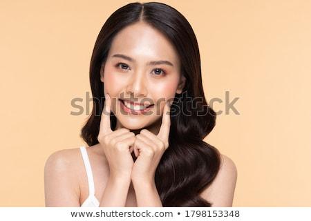 Giovani asian donna crema isolato Foto d'archivio © dashapetrenko