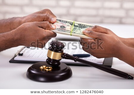 husband and wife fighting for money with mallet stock photo © andreypopov