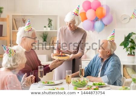 One of senior men taking plate with homemade birthday pie Stock photo © pressmaster