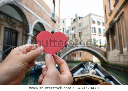 Couple Holding Heart Shape While Riding Gondola Stock photo © AndreyPopov