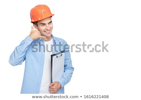 Young architect pointing to distance smiling stock photo © nyul