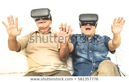 Yaşlı adam sanal gerçeklik kulaklık 3d gözlük teknoloji Stok fotoğraf © dolgachov