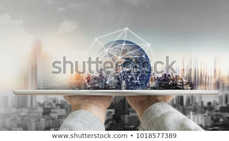 holding tablet with global database  Stock photo © ra2studio