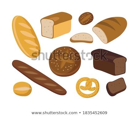 White bread with sesame in the hands of a baker Stock photo © galitskaya