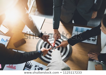 Business person aiming at target. Stock photo © lichtmeister
