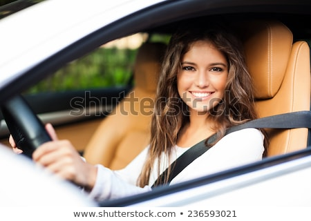 Young female driver driving her car  Stock photo © lightpoet