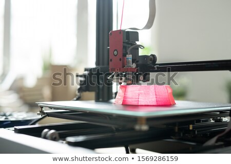 Printhead of 3d printer moving over foundation of pink round object Stock photo © pressmaster