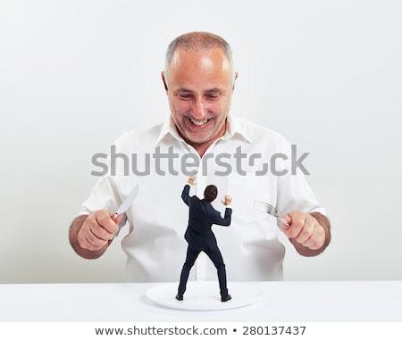 Big businessman eating small man Stock photo © ra2studio