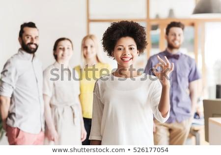 Lächelnd junger Mann Handzeichen Büro Stock foto © dolgachov
