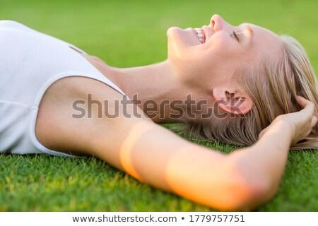Gelukkig jonge vrouw sofa warm gloed Stockfoto © Giulio_Fornasar