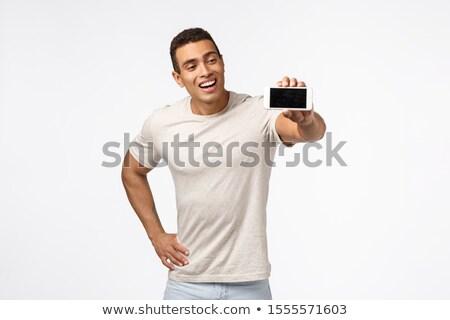 парень наслаждаться играет новых мобильных игры Сток-фото © benzoix