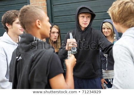 Teenager gang hanging out together Stock photo © bluering