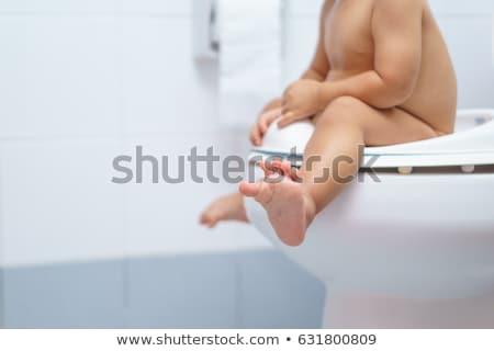 Child sitting on toilet potty Stock photo © ia_64