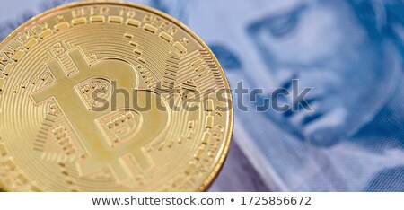 Gold coin Bitcoin on the background of hundred dollar bills Stock photo © butenkow