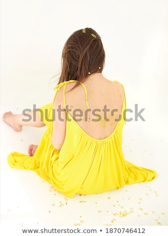 Anonymous young woman with confetti Stock photo © dashapetrenko