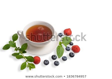 Strawberries on green chinese saucer Stock photo © RuslanOmega
