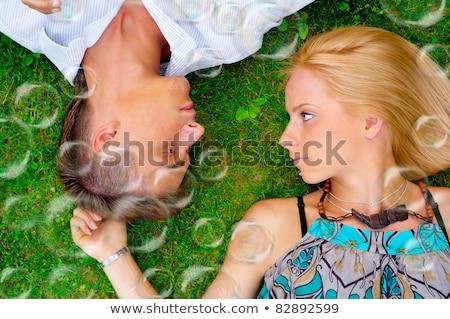 Portret zoete paar liefde zeepbellen rond Stockfoto © HASLOO