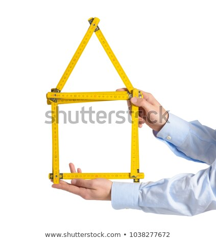 Man holding house-shaped measuring device Stock photo © photography33