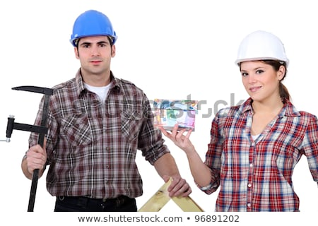 A team of tradespeople holding their tools and a house model Stock photo © photography33