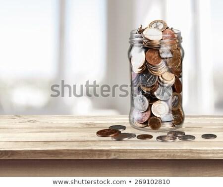 Munten jar witte geld achtergrond groep Stockfoto © FOKA