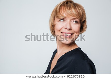 Blond woman looking sideways Stock photo © photography33
