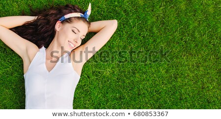 Summer girl in grass Stock photo © Maridav