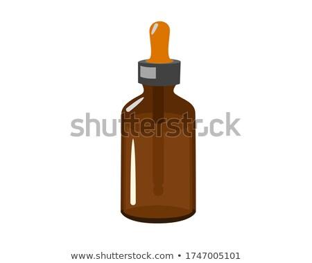 Piccolo bottiglie buio fluido indietro uno Foto d'archivio © veralub
