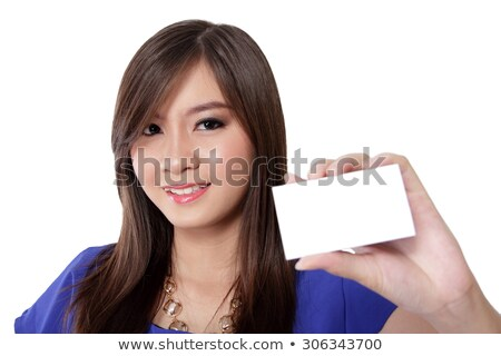 Businesswoman holding up her blank ID tag Stock photo © stryjek