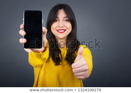 Stock photo: A young road giving the thumb up by a blank sign.